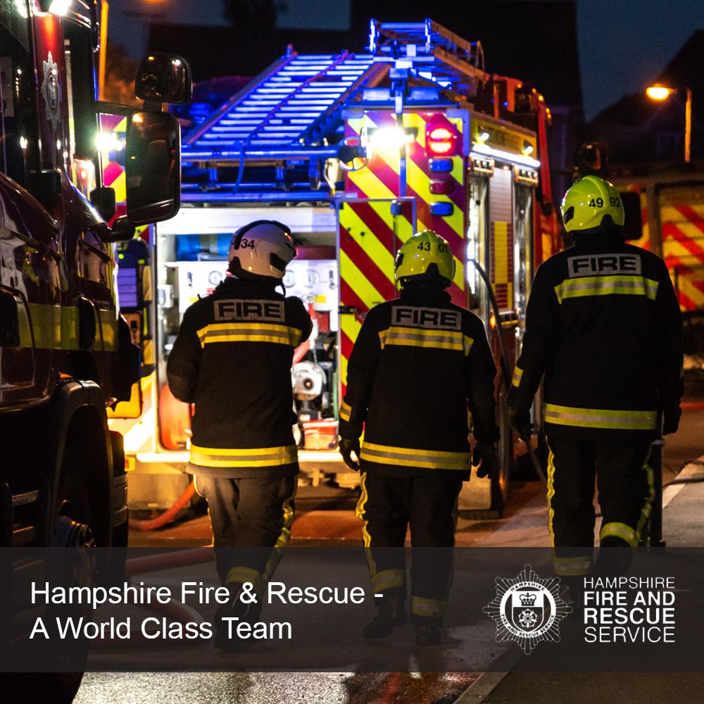 Team of fire fighters in a street scene