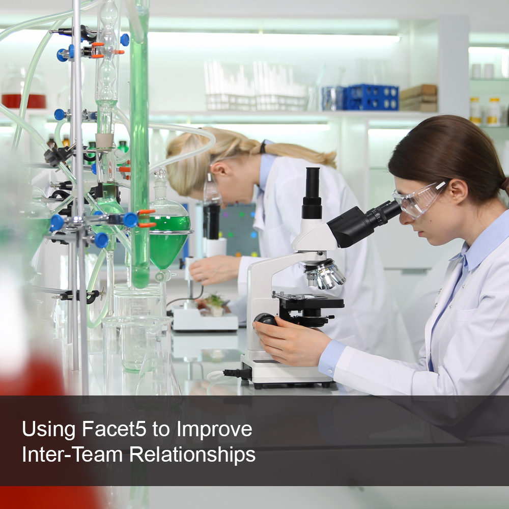 Team members working together in a science lab.